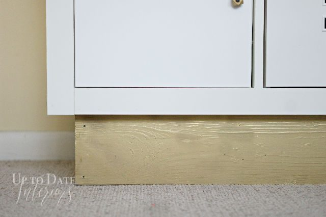 Close Up Of Gold Wood Base For Kallax Bookcase