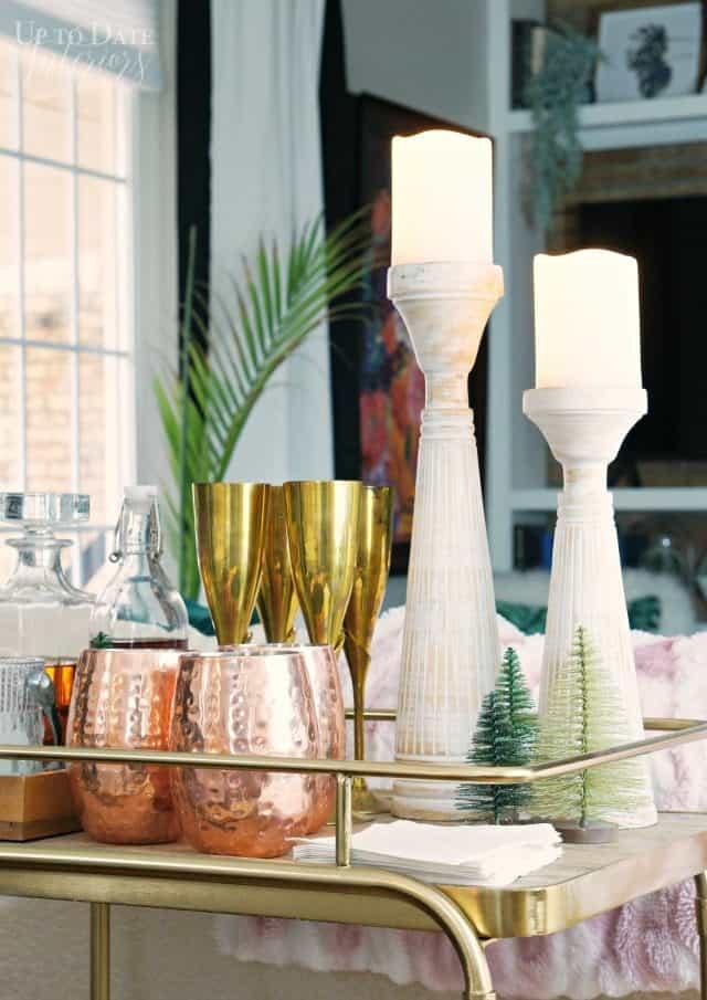 candles-copper-mugs-gold-champagne-glasses-bar-cart