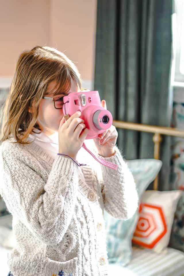 Girl Taking Picture with pink polaroid