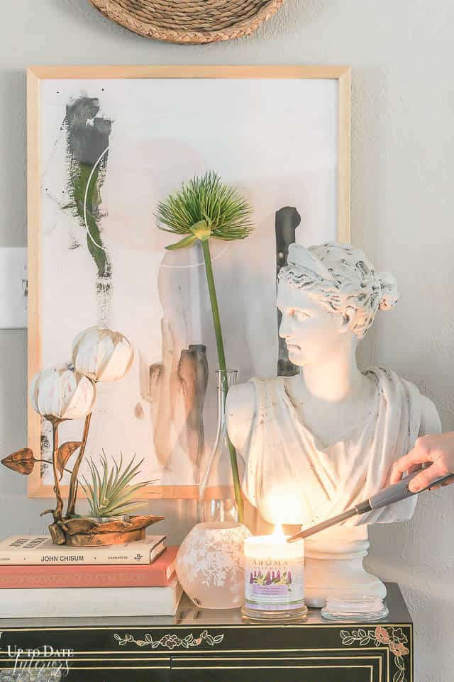 lavender-and-ling-lang-soy-candle-with-a-womans-bust-and-art-and-books