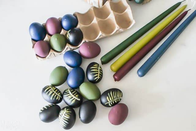 Diy Easter Eggs Botancial Hand Painted Moody Colors with candle sticks on a white table