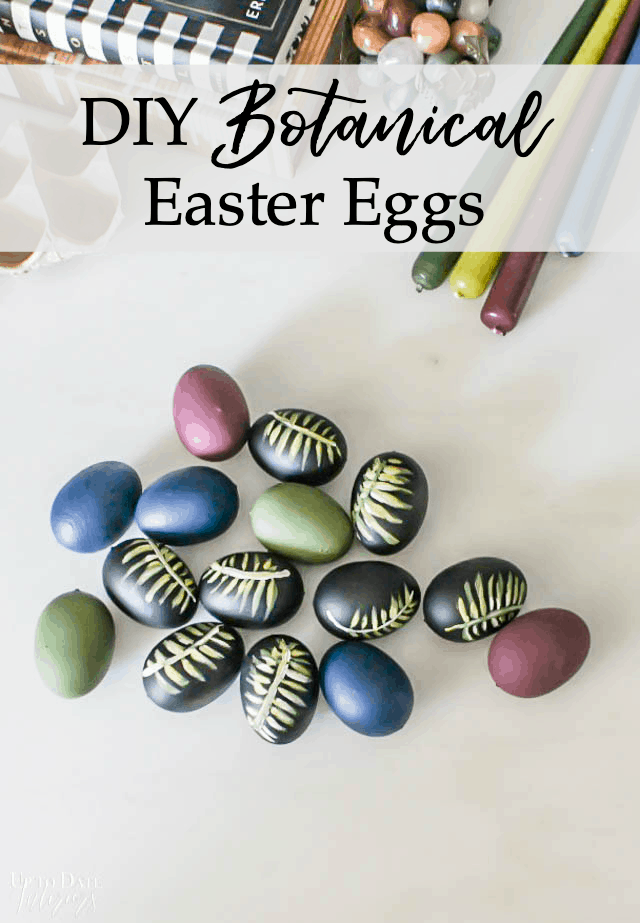 Diy Botancial Hand Painted easter eggs in Moody Colors on a white table with candles and books