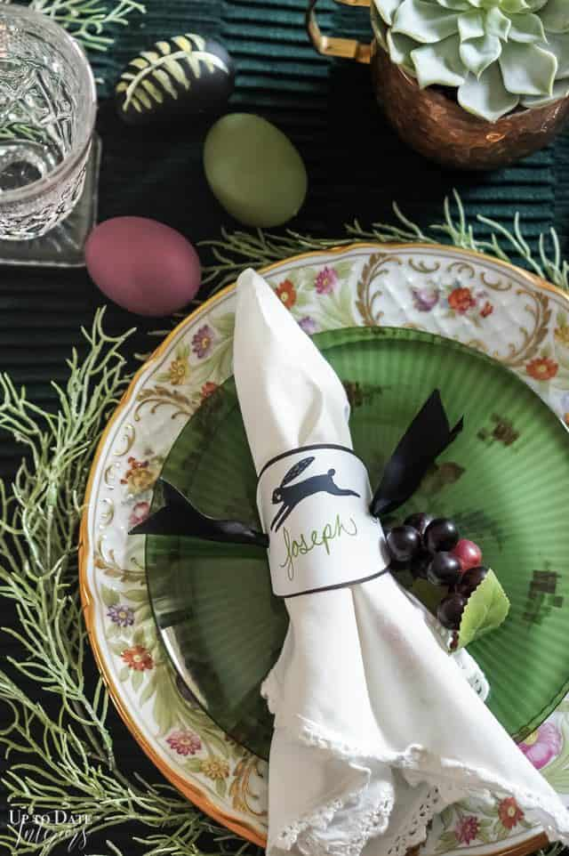 Black Rabbit Place Card Napkin Ring place setting with greens and purples