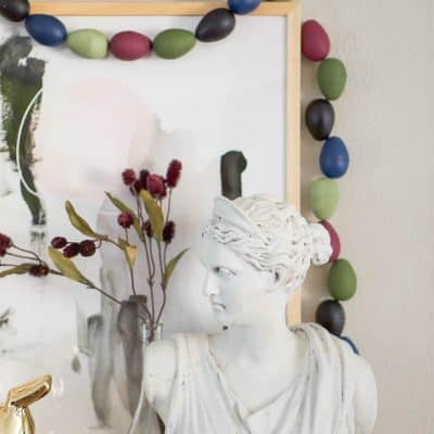 Egg Garland around art and a woman's bust