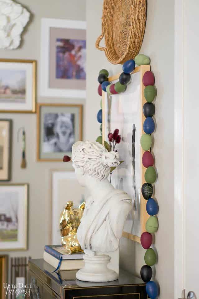 modern DIYeaster egg garland around a wall of art