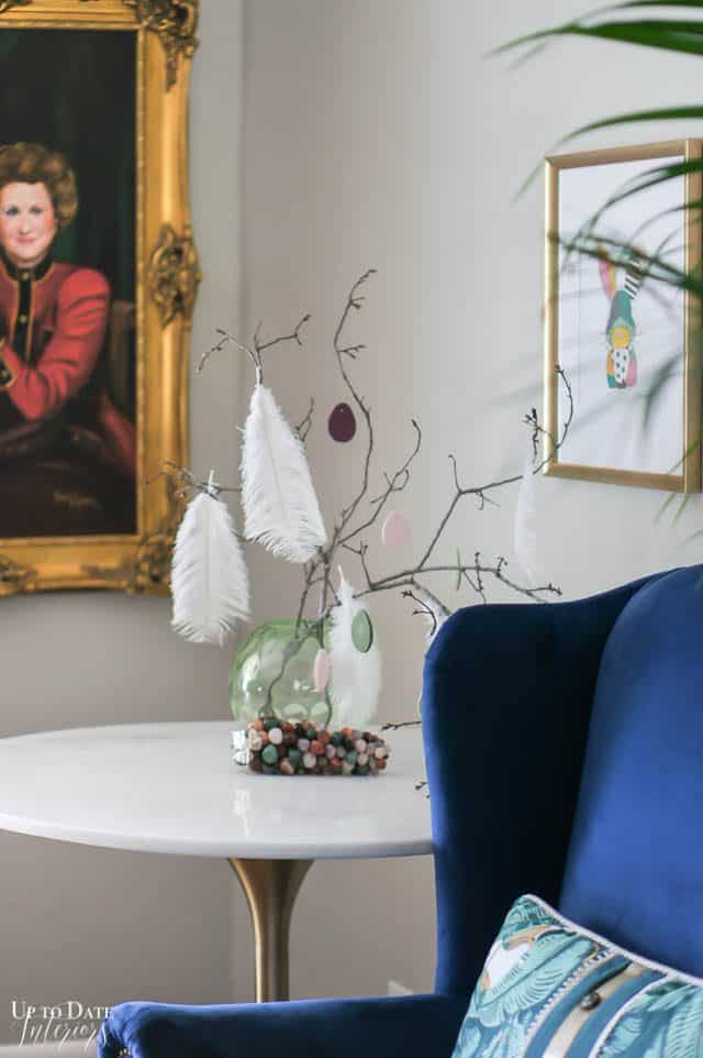 Easter Tree With Clay Eggs and portrait in the background. Tulip table with blue armchair.
