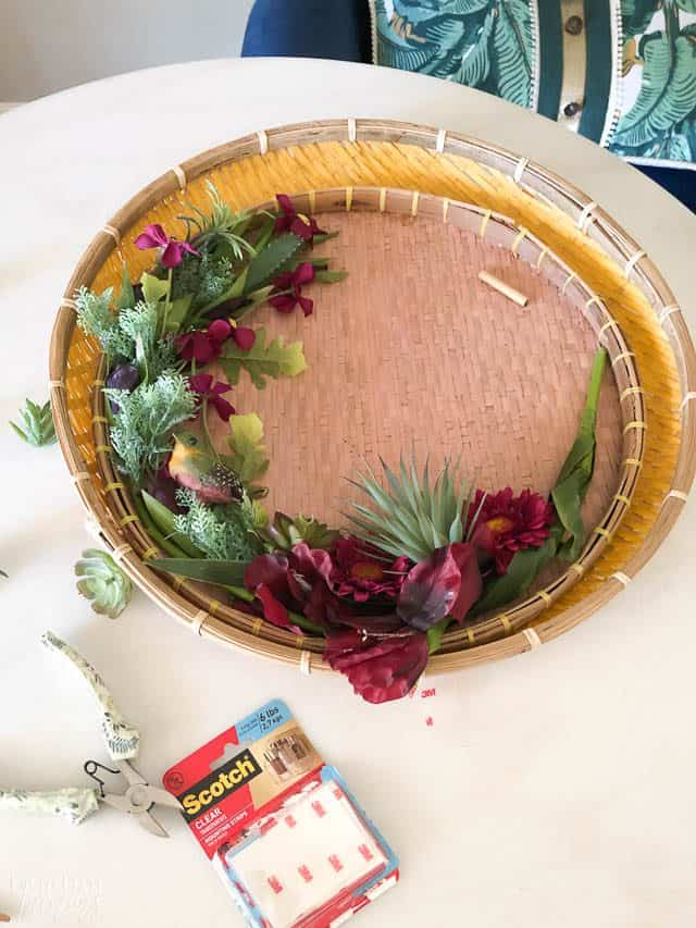 Elegant And Modern Spring basket Wreath with green and purples on a white table