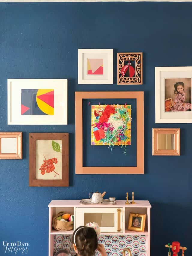 blue wall with art gallery in a girls room