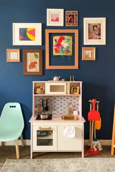 Ikea Play Kitchen Makeover with Velvet Finishes on a navy gallery wall