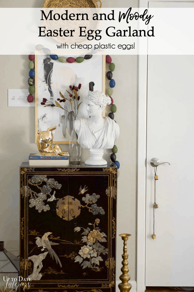 Modern Moody Egg Garland around a foyer vignette with an asian cabinet