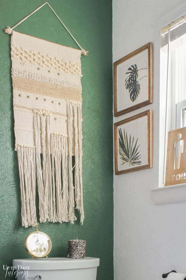 Small Bathroom Makeover Ideas with green wall and bathroom wall art using botanicals and woven wall hanging