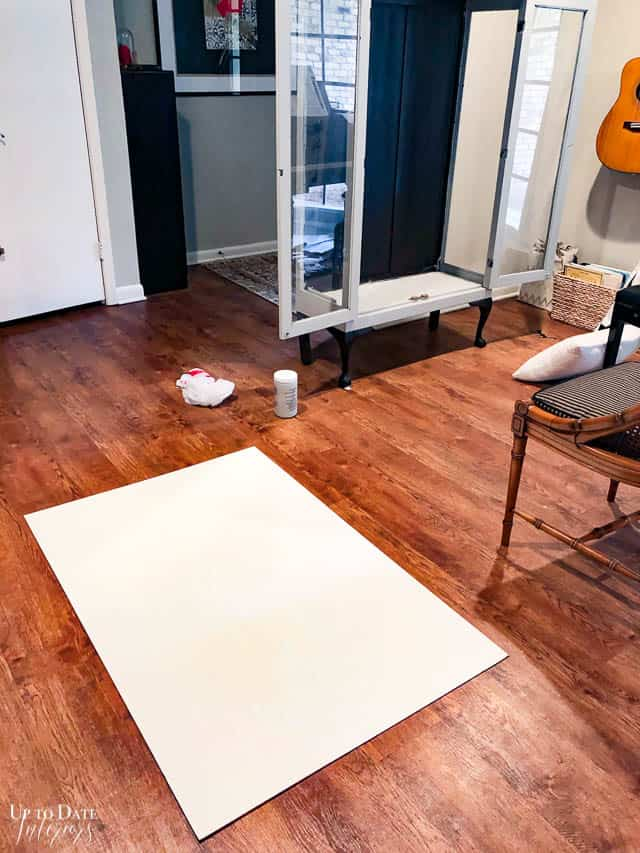 press wood sheet on floor for a cabinet makeover