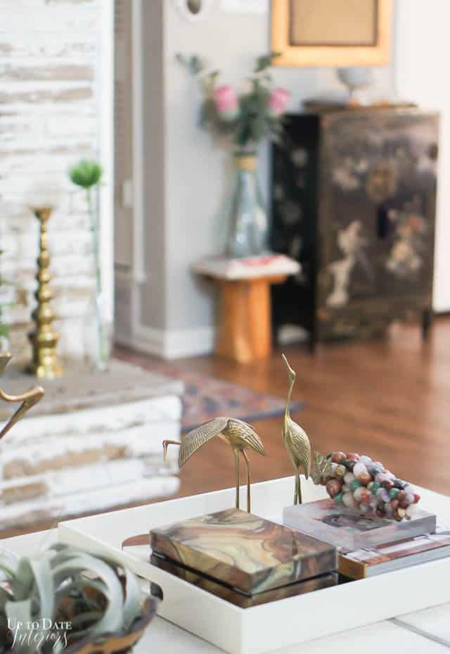 brass birds coffee table styling