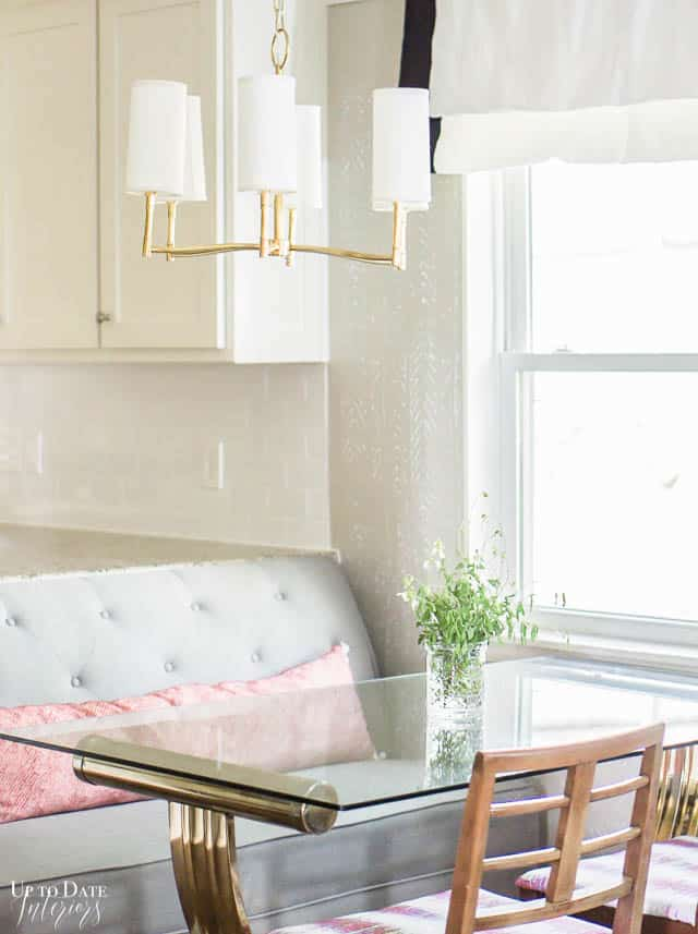 small-dining-area-next-to-kitchen-with-banquette-seating-and-chandelier