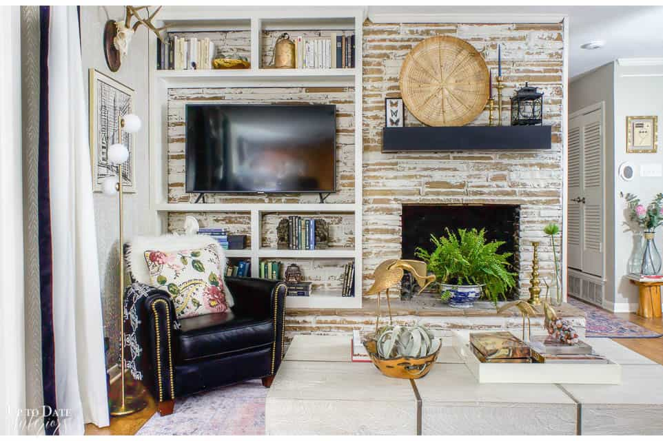 german schmear mortar wash fireplace with global eclectic decor bright and colorful