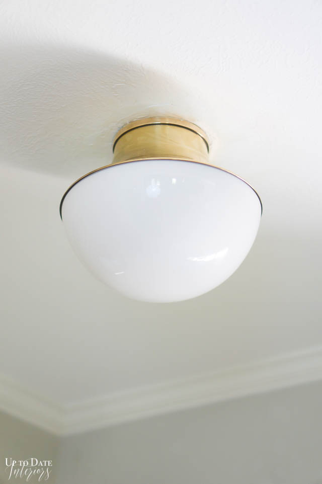 close up of gold and white round flush light