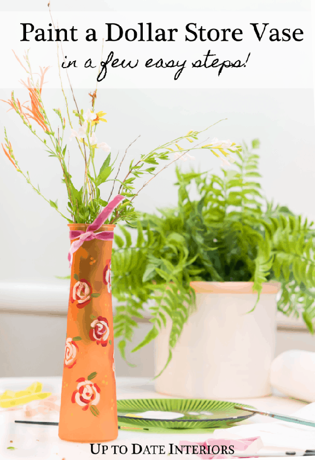 painted roses on orange glass vase with herbs and a fern with painting supplies