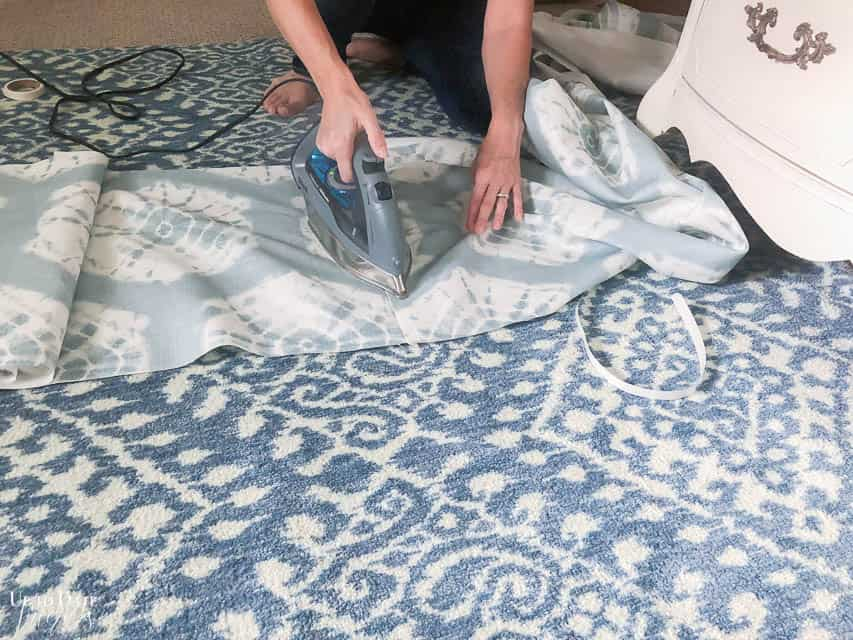 Use iron on fusing tape for an easy no-sew method bed skirt