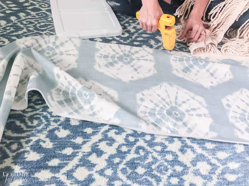 Making an easy queen sized bedskirt with shibori fabric and hot gluing tassel trim on