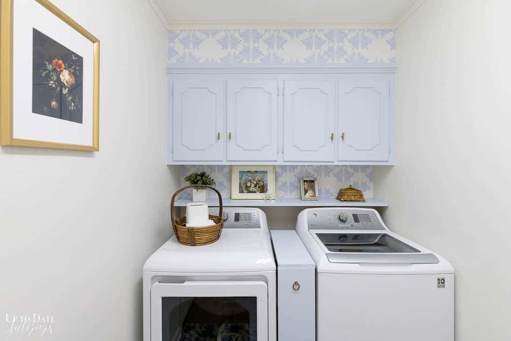 Diy Laundry Room Makeover on a budget wide angle with art and blue and white wallpaper Edited 4