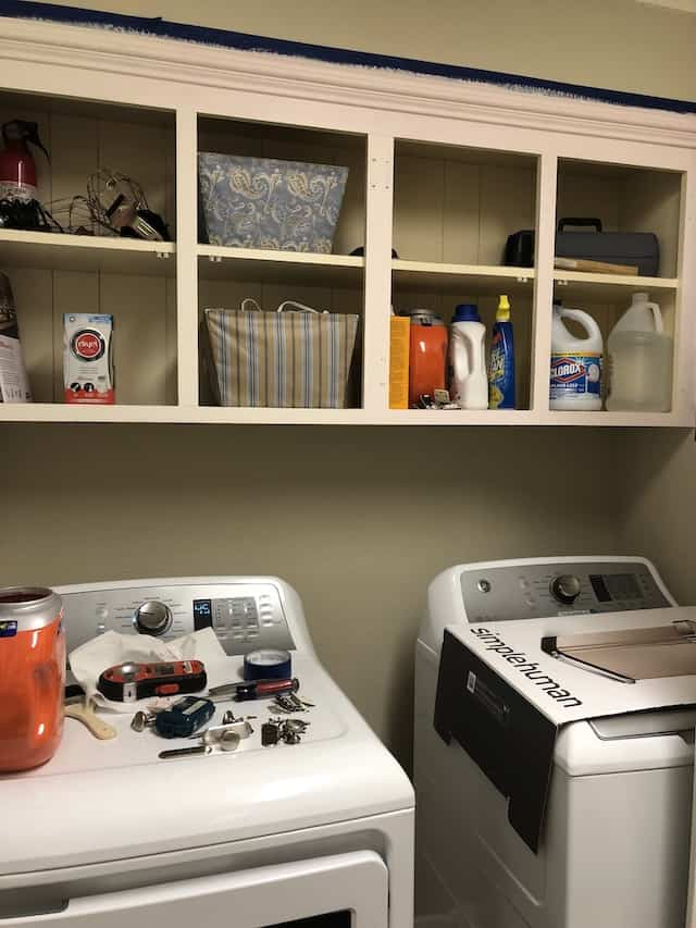 laundry room with messy cabinets