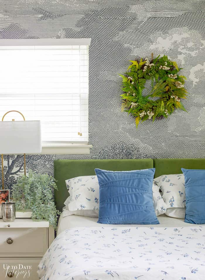 Summer Bedroom green and bedroom bedding and decor with white nightstand, side window, and mural on the wall.