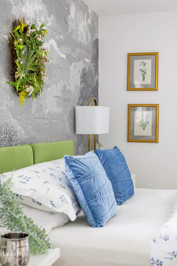 Summer Bedroom view of headboard and pillows with botanical wall art