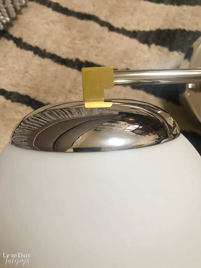 Bathroom vanity light on zebra rug.