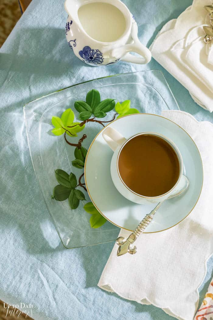 coffee in blue cup and saucer on blue tablecloth