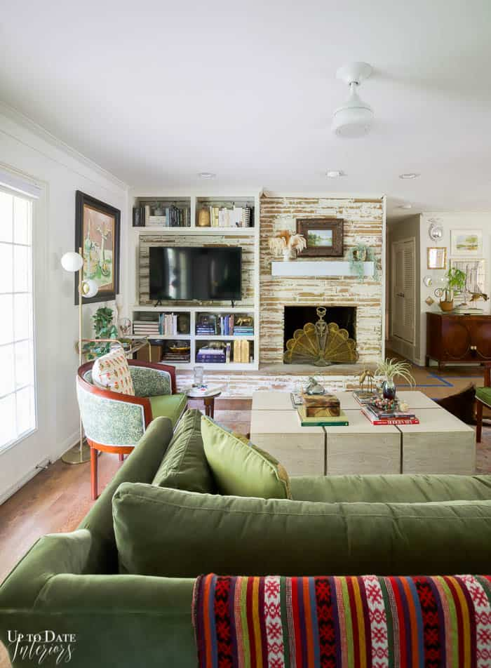 Living Room with Green Velvet Sofa and German Smear Fireplace