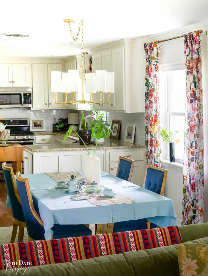 blue and green dining room with bright floral curtains